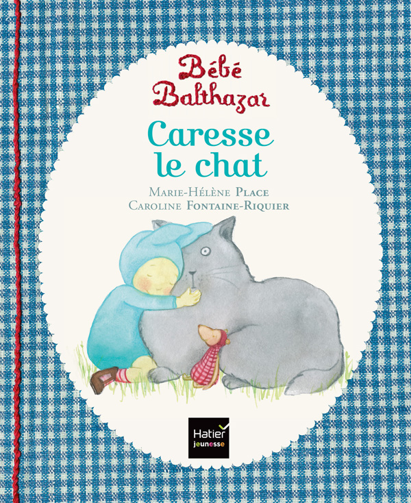 Bébé Balthazar caresse le chat